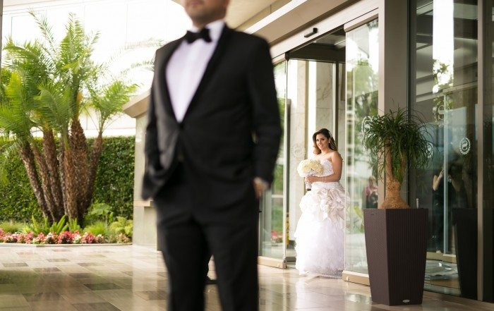 bride walking toward groom for first look