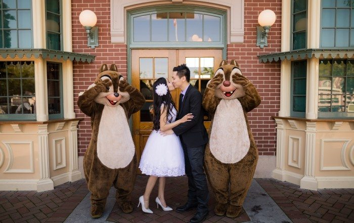 couple showing a little PDA at disneyland
