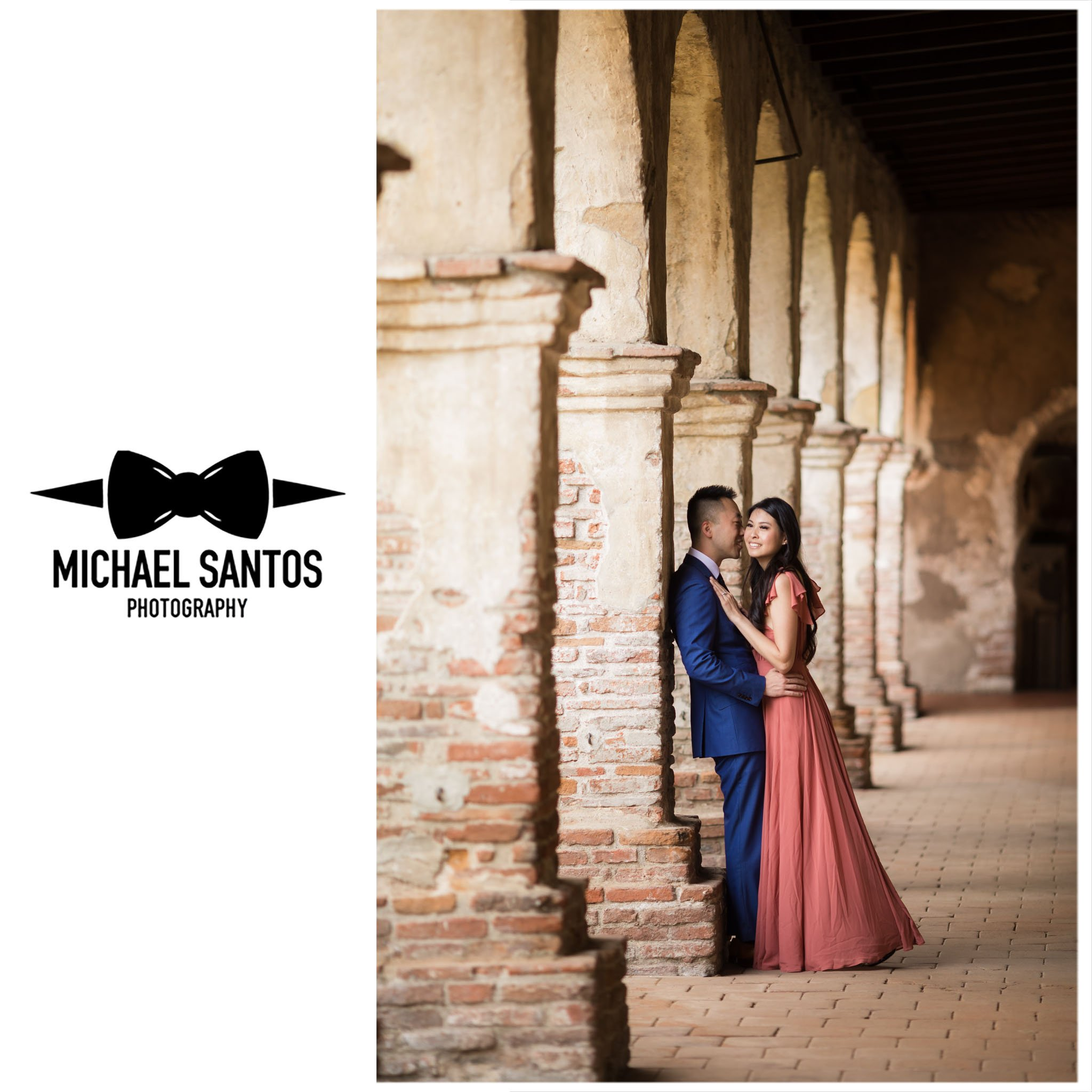 couple leaning against hallway wall smiling at their mission san juan capistrano engagement session